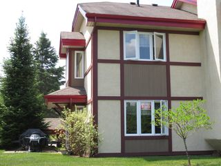 Mont Tremblant townhome photo - Back of the House, with BBQ on the Left