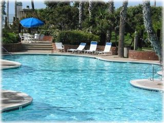 Oceanside condo photo - North Coast Village pool complex - hot tub and putting green too!