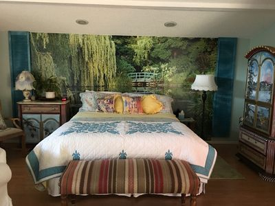 Very comfortable king bed with backdrop of Monets Garden in Giverney.