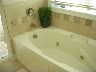 Gold Coast condo photo - Master Bathroom Jacuzzi Tub and tiled shower with double sinks