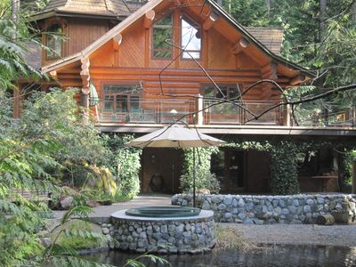 Enjoy the tranquil koi fish pond viewed from in the 10 person hot tub.