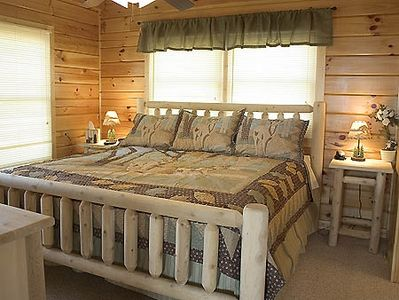The second bedroom is decorated with rustic decor