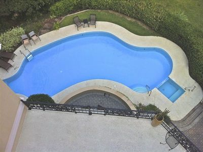 Refreshing full-sized private pool with beautiful lake views from pool deck.