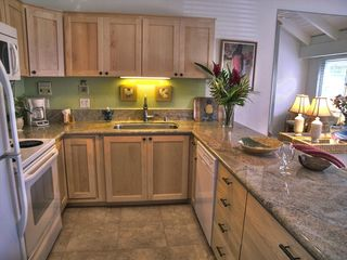Poipu condo photo - Kitchen open to the family room. Updated recently with granite and cabinetry