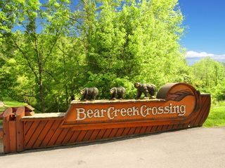 Pigeon Forge cabin photo - The Bear Creek Crossing bears greet you at the main entrance