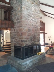 Natural stone chimney makes for cozy and romantic evenings by the fire.