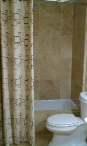 Second bath travertine tile walls and floor