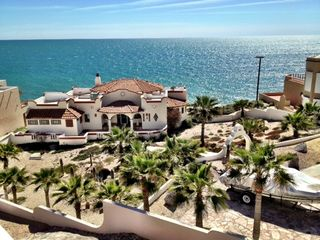 Puerto Penasco house photo - The yard is coved with beautiful shells. Lots of Palms and a cactus garden.