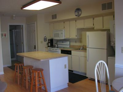 Well equipped kitchen . Washer dryer on right