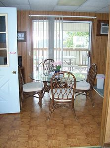 Cedar property has large kitchen with dining area - sit and enjoy lake view