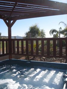 Avondale house rental - 6 person hot tub with Estrella mountains in back ground