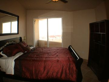 Master bedroom with king bed, ocean view, TV and DVD, huge closet and bathroom.