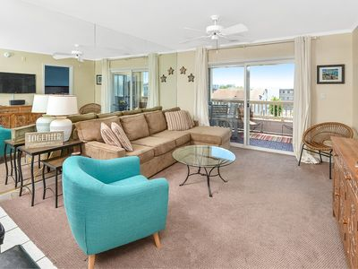 "Welcome to ""Latitude Adjustment""! A spacious 3bd/2ba waterfront condo."