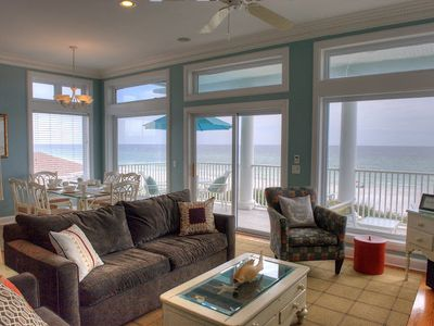 Den Area with Large Windows and Ocean Front Balcony