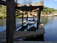 Beautiful 3BR/3BATH 2 Story with Decks Over the water and Dockage for your boat.