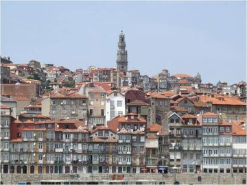 Oporto view with clerigos tower, building ribeira