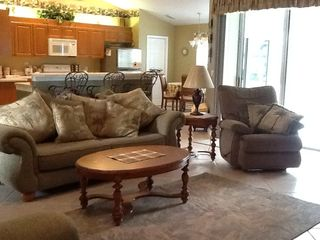 Vacation Homes in Marco Island house photo - Great Room and Kitchen lead to Pool Deck