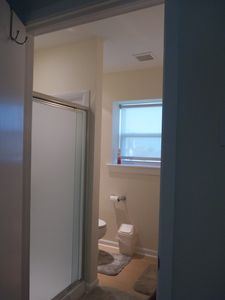 Upstairs bathroom with toilet, vanity and shower