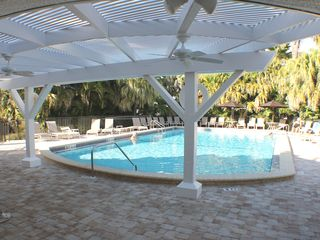 Sanibel Island condo photo - Island Beach Club pool with new pavers, umbrellas, and furniture