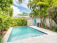 Two neighboring homes w/ private pools & modern luxury - walk to beach!
