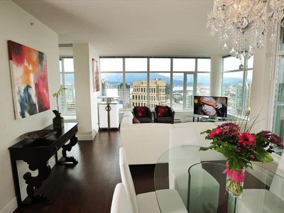 Dining & Living area with modern, upscale furniture and view, view, view!