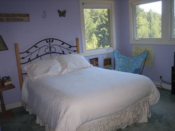 Primary rental bedroom with full sized bed and private full bath.
