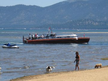 View from the private Tahoe Keys beach. The famous Thunderbird wooden boat.