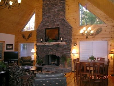 Family Room with Stone Fireplace. Dining Area