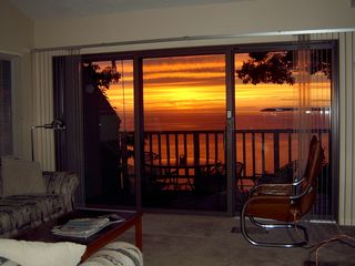 Glen Arbor condo photo - Sunset from Living Room ; Patio table with 4 chairs; South Manitou Island
