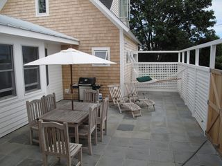 Scarborough and Pine Point house photo - Interior patio with gas grill, dining, chaise lounges and hammock