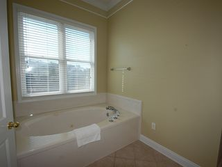 Fort Morgan property rental photo - The jetted garden tub is the perfect place to spend the evening away from it all