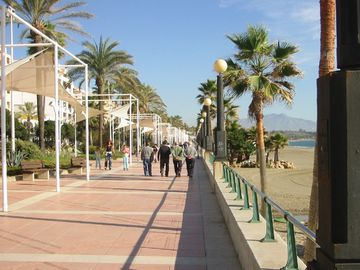 Stroll along the Paseo Maritimo in to the old town