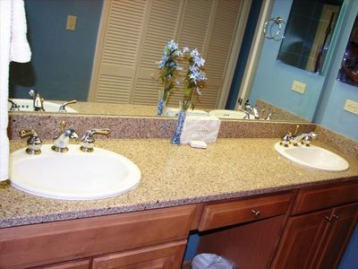 Newly renovated bathrooms with granite countertops.