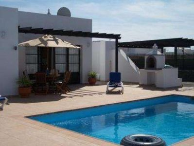 Villa AMANDINA in Playa Blanca for 6 persons with pool terrace garden and views to the ocean and with WIFI on the go and less than 300m from the beach