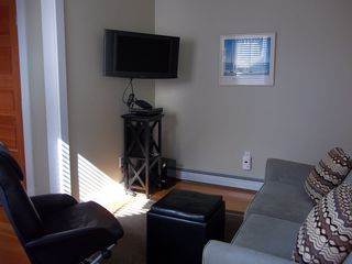 Provincetown condo photo - Living room with entertainment center
