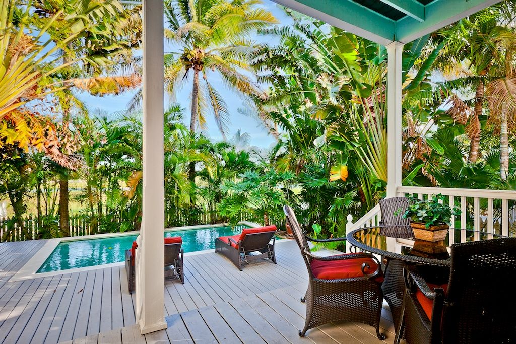 Key West Themed Backyard : Dine on the back porch overlooking the largest private pool at the