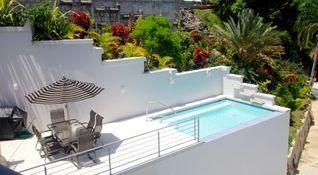 Rincon apartment photo - Pool dining, wet bar and grill surrounded by lush green nature