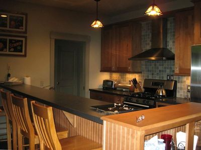 Fully equipped Kitchen Opens to Great Room with view of woods.