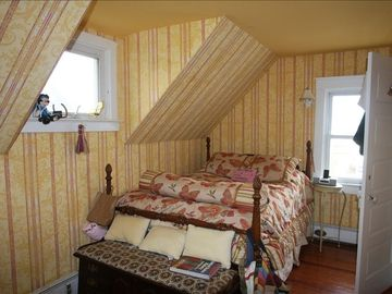 Bedroom w/ full size bed. 7 bedrooms include 3 twins 3 fulls 1 queen & 1 king