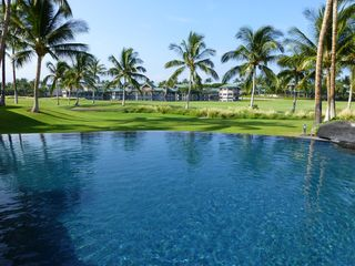Waikoloa Beach Resort condo photo - The infinity pool with the King's Shops in the background