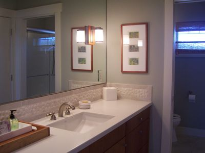 Master bathroom sink. Master bath has double shower and heated tile flooring