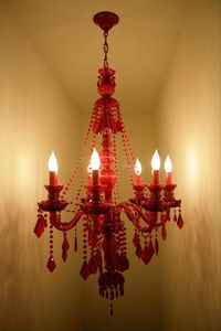 Gorgeous red crystal chandelier in the stairwell