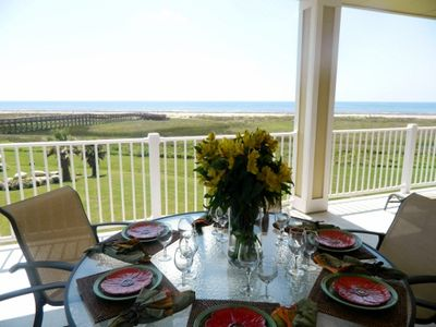 Enjoy a beachfront dinner on the expansive patio.