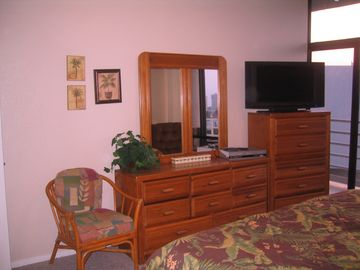 Master Bedroom has storage and comfort with HD TV.