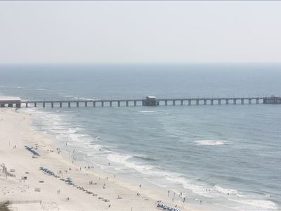 pretty white sand and view of the largest public pier in the Gulf