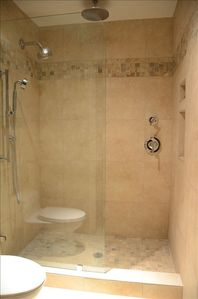 Newly remoded shower area with rain shower, fixed and hand-held shower! Amazing!