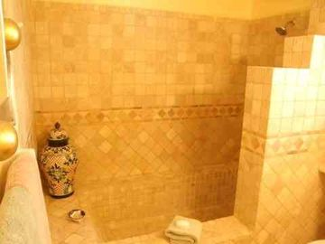 The shower/tub in the all stone and granite master bath