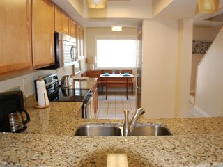 "St. Augustine Beach house photo - ""Surf"" desogner kitchen with stainless steel appliances, granite countertops"