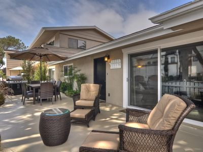Large outdoor patio with BBQ is the entry to an amazing vacation at the beach