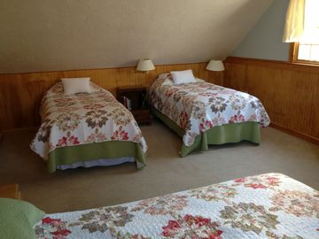 Twin beds in 2nd floor bedroom.